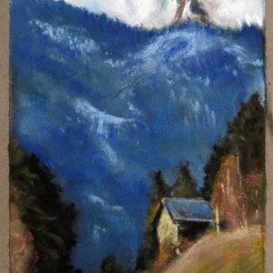 Hütte mit Bergspitze